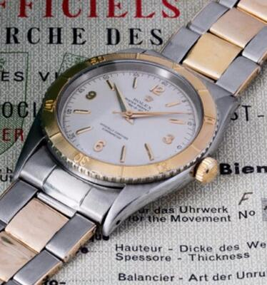 The gold hands and hour markers are striking on the white dial.